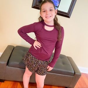 Girls cut out top long sleeves in purple.